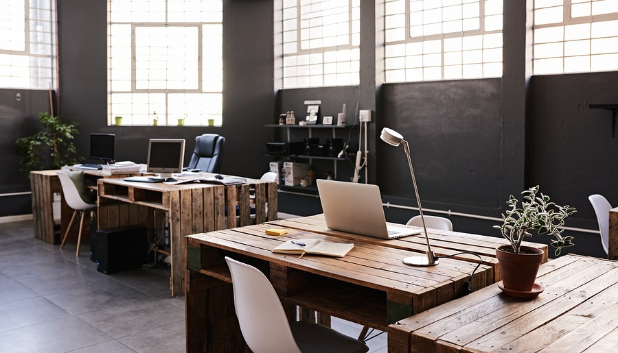 Modern office design in brown colours with wood